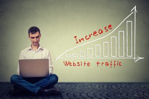 Man increasing website traffic with graph